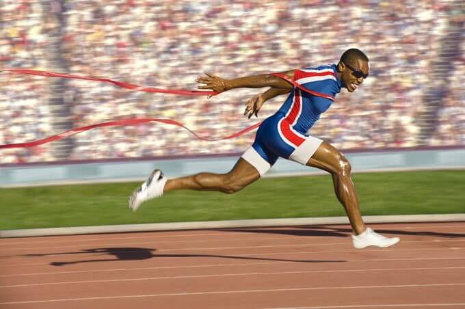 Image of a runner crossing the finish line